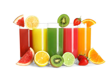 Glasses with different juices and fresh fruits on white background Stock Photo