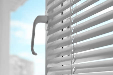 Closeup view of window with blinds. Space for text