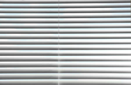 Closeup view of window with horizontal blinds