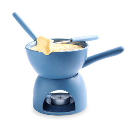 Pot of delicious cheese fondue and fork with bread on white background