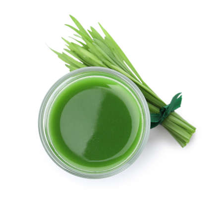 Glass of fresh wheat grass juice and sprouts on white background, top view 스톡 콘텐츠