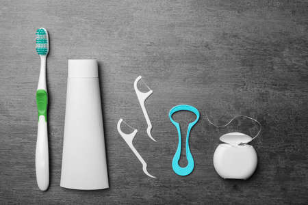 Flat lay composition with tongue cleaner and teeth care products on grey background 스톡 콘텐츠