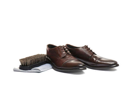 Stylish men's footwear and shoe care accessories on white background Zdjęcie Seryjne - 125165913