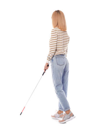 Blind person with long cane walking on white background