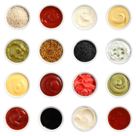 Set of different delicious sauces on white background, top view Imagens