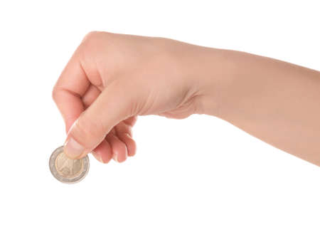 Woman holding coin in hand on white background, closeup Zdjęcie Seryjne
