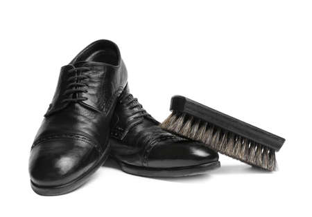Stylish mens shoes and cleaning brush on white background Zdjęcie Seryjne