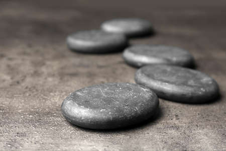 Spa stones on grey background. Space for text