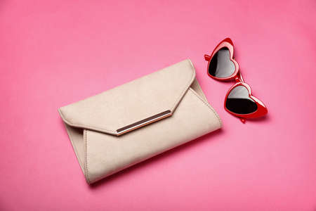 Stylish heart shaped glasses on color background, top view Stock fotó