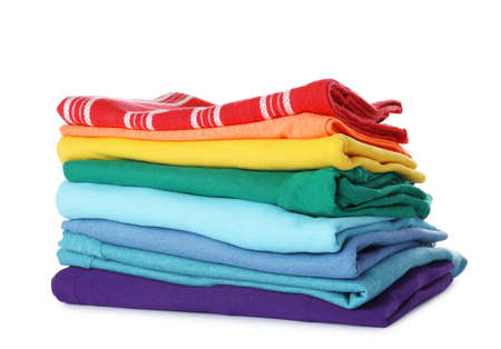 Stack of folded clothes on white background
