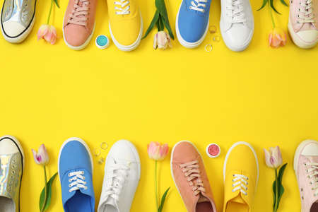 Flat lay composition with different sneakers and accessories on color background, space for text. Trendy spring look 免版税图像