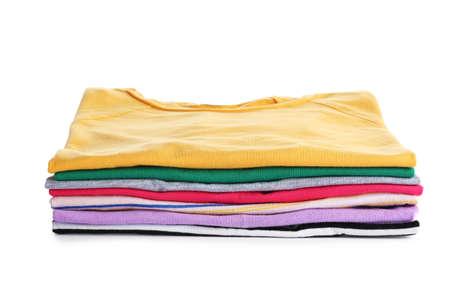 Pile de vêtements repassés isolated on white Banque d'images