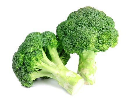 Brócoli verde fresco sobre fondo blanco. Alimentos orgánicos Foto de archivo