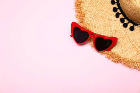 Flat lay composition with heart shaped sunglasses on color background, space for text 写真素材