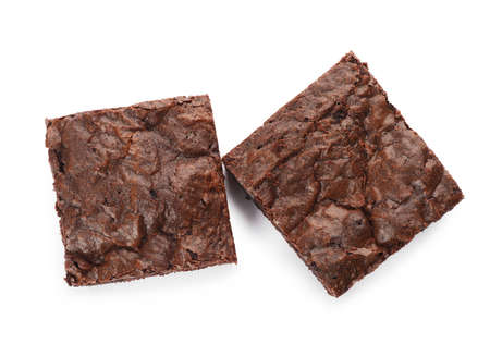 Pieces of fresh brownie on white background, top view. Delicious chocolate pie