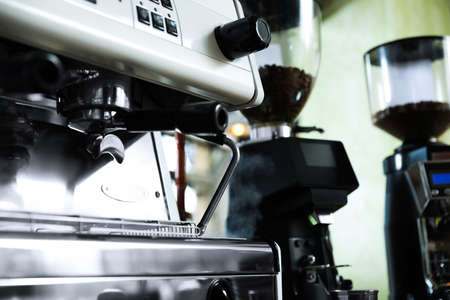 Modern coffee machine in cafe, closeup. Space for text