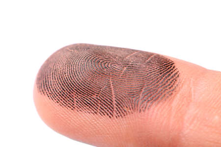 Closeup of person's finger with ink on white background. Taking prints Standard-Bild