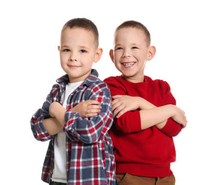 Portrait of cute twin brothers on white background Stock Photo