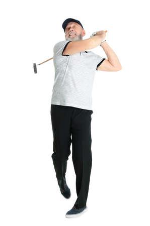Senior man playing golf on white background