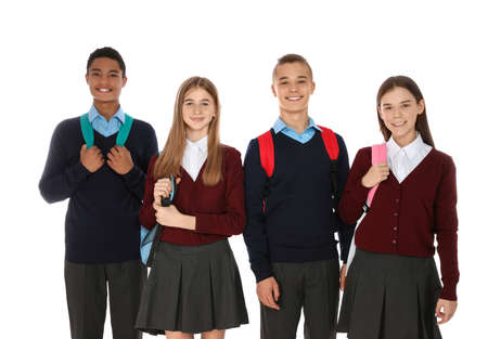 Portrait of teenagers in school uniform with backpacks on white background