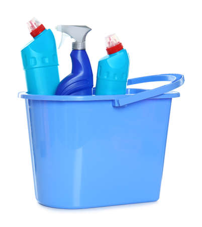 Plastic bucket with different cleaning products on white background Stock Photo