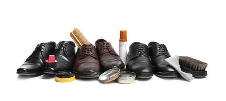Stylish men's footwear and shoe care accessories on white background Stock Photo
