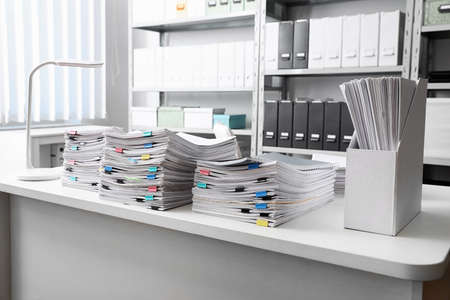 Table with lots of documents in office