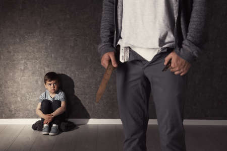 Man with unzipped pants and scared little boy indoors. Child in danger