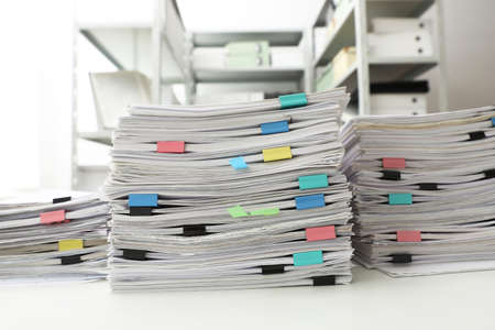 Stacks of documents with paper clips on office desk 免版税图像