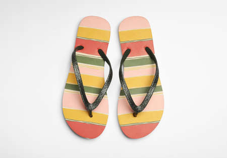 Pair of flip flops on white background, top view. Beach accessories
