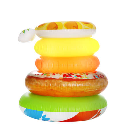 Stack of colorful inflatable rings isolated on white