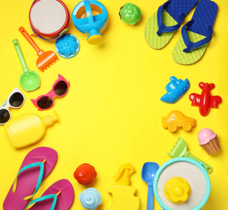 Flat lay composition with beach toys on color background. Space for text