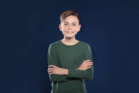 Portrait of little boy on color background