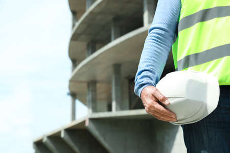 Professional builder with safety equipment at construction site, space for text 版權商用圖片