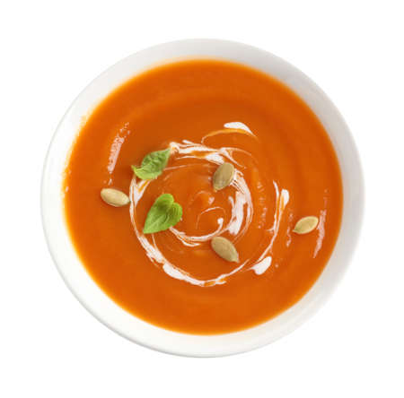 Bowl of tasty sweet potato soup isolated on white, top view Imagens