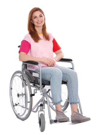 Bella mujer en silla de ruedas aislada en blanco Foto de archivo