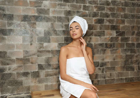 Portrait of young woman in salt sauna at luxury spa center