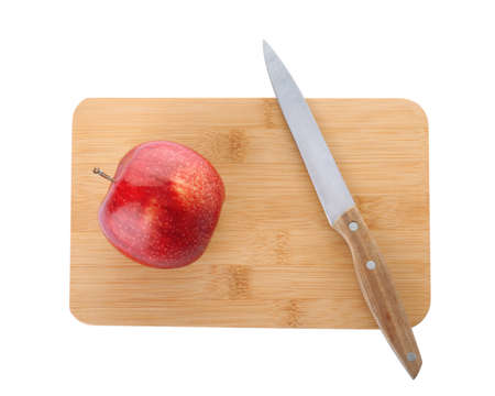Wooden cutting board with apple and utility knife isolated on white, top view Stock Photo
