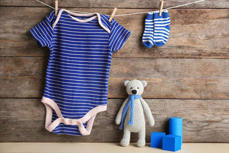 Composition with baby accessories on wooden background