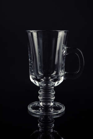 Clean empty mulled wine glass on black background Stock Photo