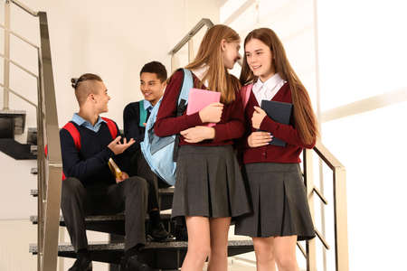 Group of teenagers in school uniform indoors