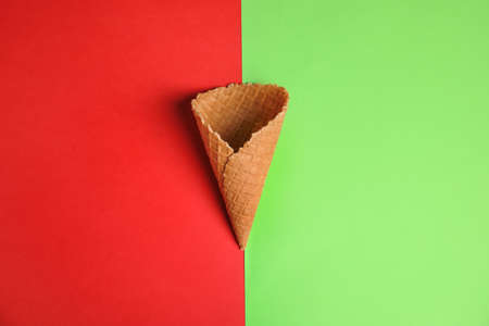 Waffle empty ice cream cones on color background, flat lay