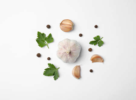 Flat lay composition with green parsley, pepper and garlic on white background
