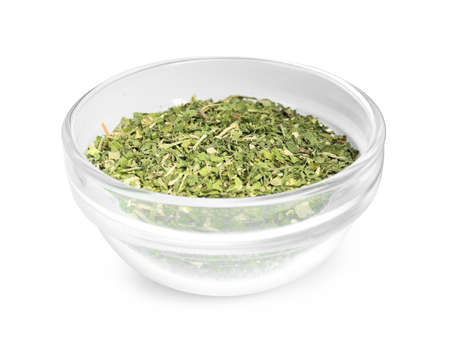 Bowl with dried parsley on white background