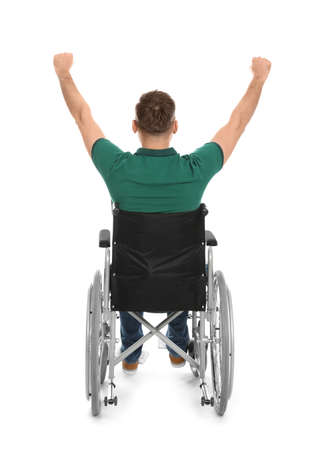 Emotional young man in wheelchair isolated on white