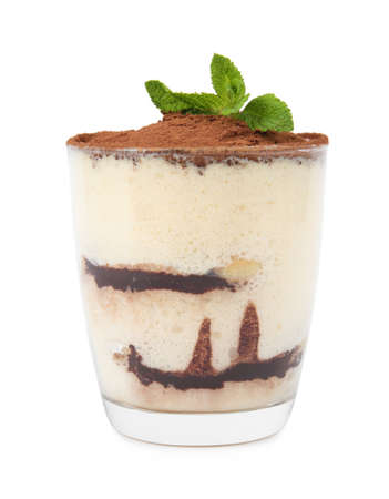 Delicious tiramisu cake in glass with mint isolated on white