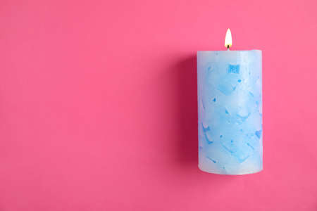 Alight wax candle and space for text on color background Reklamní fotografie