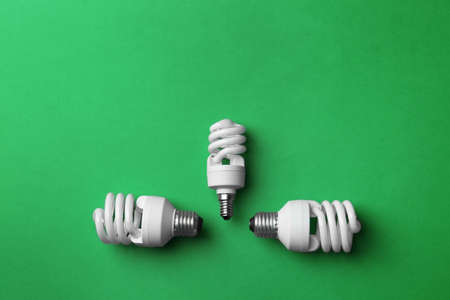 New fluorescent lamp bulbs on green background, top view 写真素材
