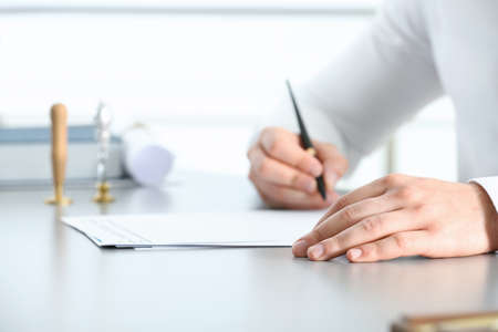 Male notary working with documents at table, closeup Stock Photo