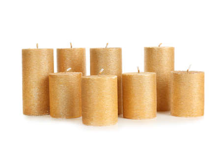 Stylish elegant gold candles on white background. Decor element Banque d'images